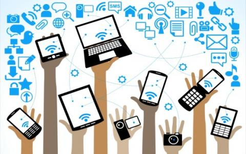 Graphic with hands holding many devices.